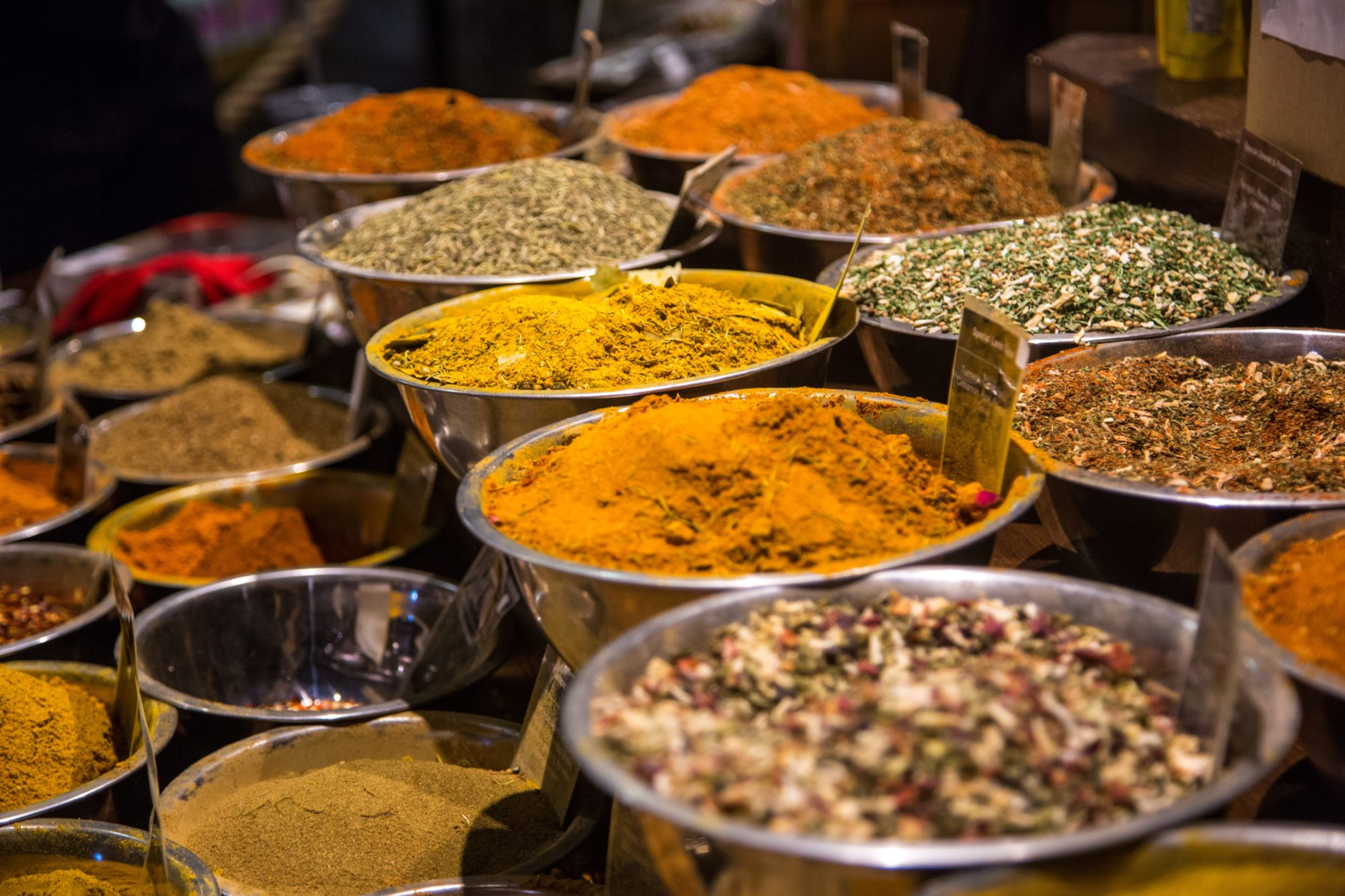 An array of spices in steel bowls